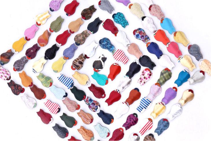 世界中から集めたデッドストックの革や限定生産の革製ですべて1点もの!猫のうしろすがたをしたキーケース